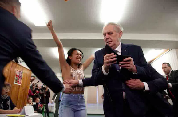 Topless Protester Welcomes Zeman to Polling Station with
